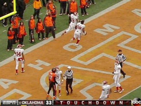Erik Striker celebrates scoring a touchdown against Oklahoma State.