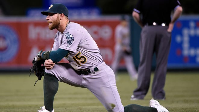 Brett Lawrie looks on during a pitching change at Angel Stadium of Anaheim.
