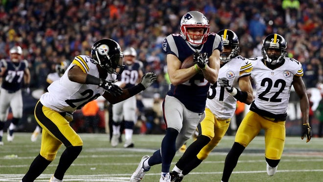 Patriots receiver Chris Hogan runs after catching a pass during the second half of the AFC championship.
