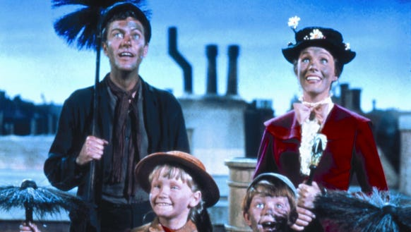 Bert (Dick Van Dyke), Mary (Julie Andrews), Jane (Karen Dotrice) and Michael (Matthew Garber) 'Step in Time' on the rooftops with chimney sweeps in the 1964 movie musical 'Mary Poppins.'