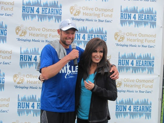 Justin Osmond, left, talks with his aunt Marie Osmond on Saturday, May 9, 2015, at St. George's Confluence Park after Justin arrived at the end of his 250-mile, eight-day run to raise money and awareness for the hearing-impaired. Justin, who has 90 percent hearing loss, is the son of Osmond Brothers founding member Merrill and is the founder and CEO of the Olive Osmond Hearing Fund named after his grandmother, the matriarch of Utah's most famous musical dynasty.