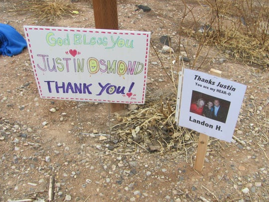 One of the many signs featuring recipients of the Olive Osmond Hearing Fund's latest benefit awaits Ephraim resident Justin Osmond as he completed a 250-mile run Saturday in St. George to raise awareness and money for the hearing-impaired.