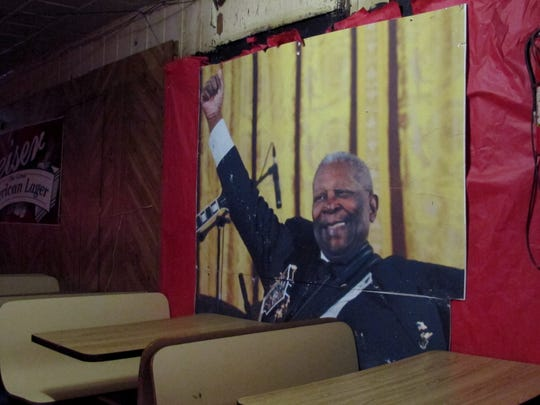 A large photo of blues guitar master B.B. King adorns a wall at Club Ebony in Indianola, Mississippi. The blues club, owned by the late B.B. King, showcased blues performers famous and unknown and serves as a gathering place for area's needy. King was among a number of legendary acts that continued to play at the club even after becoming major performers.