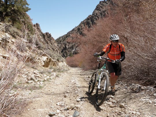 Ted Oxborrow hikes his bike up the Ophir Pass in the Toiyabe Range. The steep pass is part of the Comstock EPIC bikepacking course across Nevada.