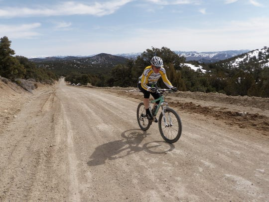 Ted Oxborrow rides along Toquima Range Road in central Nevada. The road is part of the Comstock EPIC bikepacking course that crosses the state.