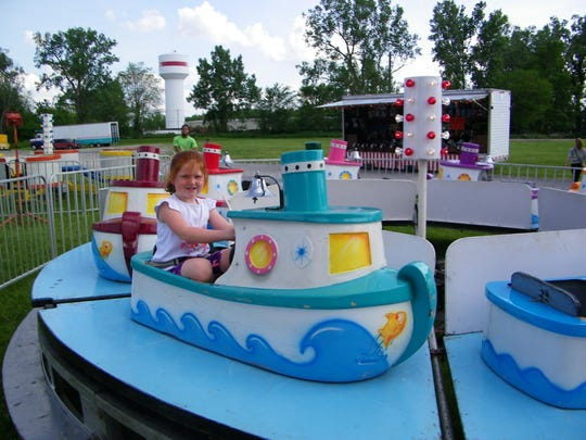 Sophie Nycz, age 4, took a spin on the boat ride during Genoa Homecoming.