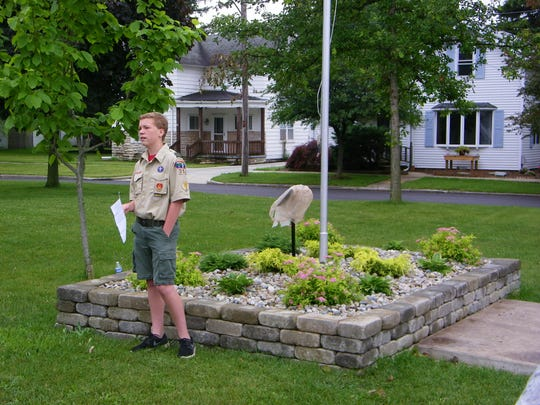 Boy Scout Justin Damschroder speaks to the crowd that