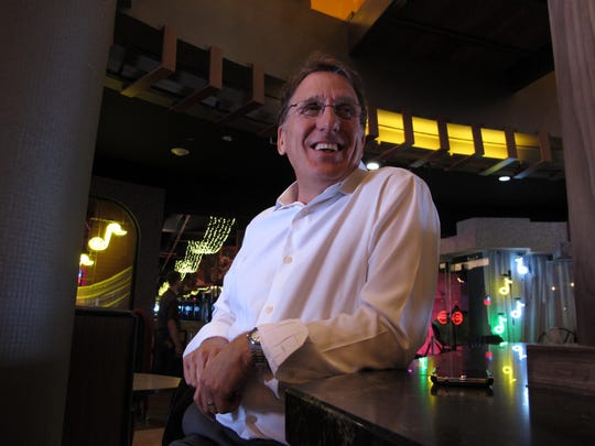 Philadelphia developer Bart Blatstein sits at The Monkey Bar, part of the $52 million Playground entertainment complex he opened in Atlantic City on Friday.
