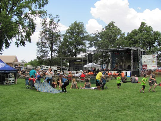 Crowds gather on the lawn of Main Street park in Cedar City to enjoy two days of music at Groovefest.