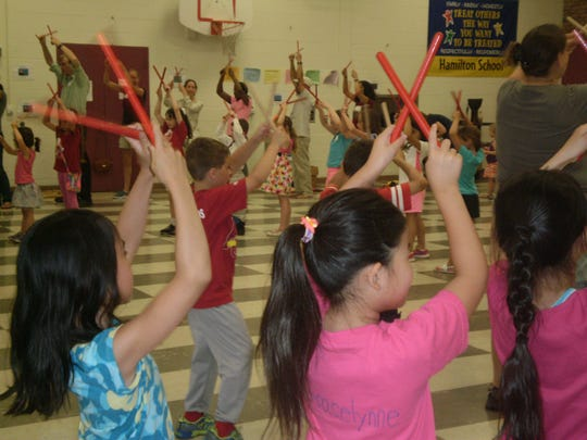 Hamilton Primary School in Bridgewater recently conducted its second annual Family Music Night. Approximately 100 participants made up of students and their families had an opportunity to sing, dance, play and create music together. This free event was put together by Hamilton School's music teacher, Rina Sklar and is run with the assistance of the PTO and some volunteer teachers. Participants had a chance to learn multi-cultural folk dances and songs, orchestrate a storybook, and learn a three-part drumming ensemble.