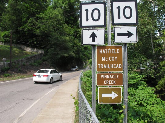 Signs advertise an all-terrain vehicle trail named for a pair of famous Appalachian feuding families in Pineville, W.V.
