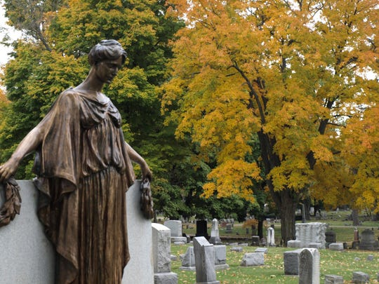 """Legend has it that """"Crying Mary"""" sheds tears at midnight each Sunday. The statue, pictured here in 2009, is one of the most popular sites at Oak Hill Cemetery."""