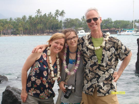 Charli, left, daughter Rosie and Jeff Lee spent two weeks in Hawaii during their first house-sitting gig in the summer of 2013.