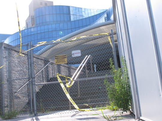 Weeds and caution tape line the entrance to the former Revel casino in Atlantic City, N.J. Friday Aug. 21, 2015.