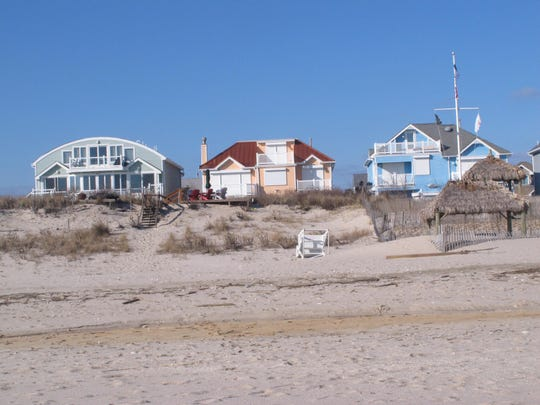 This Jan. 2, 2016 photo shows beachfront homes in a