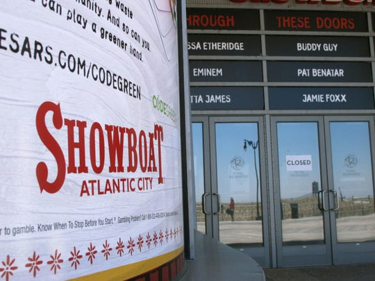This April 24, 2015 photo shows the former Showboat casino in Atlantic City N.J., which closed in Aug. 2014. A bill advancing through the New Jersey state legislature would remove competing deed restrictions on how the property can be used by new owners that have been the main obstacle to reopening the property as a casino or as a non-gambling attraction. (AP Photo/Wayne Parry)