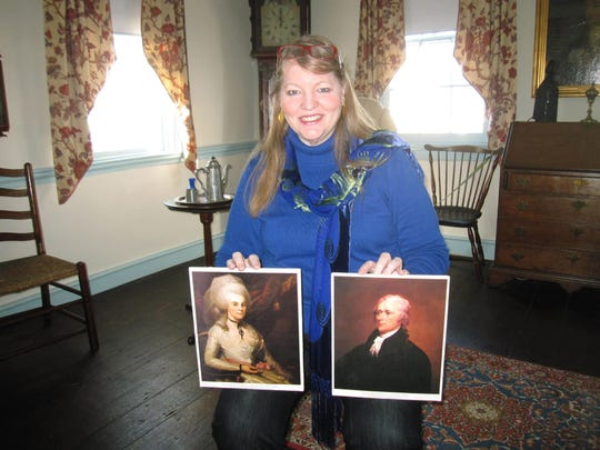 Patricia Sanftner, curator of Schuyler-Hamilton House in Morristown, N.J., holds pictures of Alexander Hamilton and his wife, Elizabeth Schuyler.