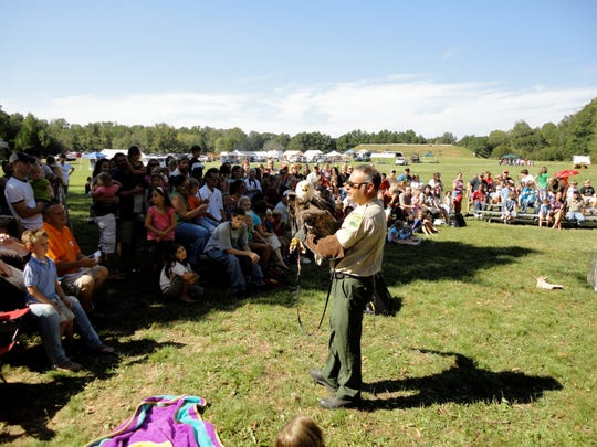 Archaeofest visitors enjoy the annual favorite of David Haggard as he presents the Birds of Prey program.
