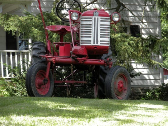 A tractor sits idly by in Orange County.