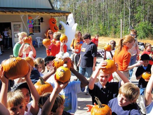 Kids on Deck with pumpkins