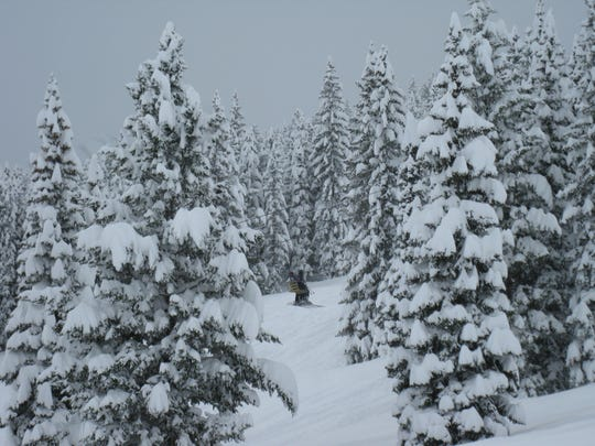 Skiers use the lift to get up the mountain at Teton Pass Ski Area, where there's more than 60 inches of fresh snow.