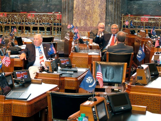 Senators talk as they await final bill debates on the Louisiana Senate floor on the final day of the special session Friday in Baton Rouge, La.