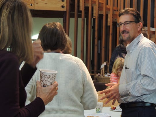 Dean Gazza, director of parks, recreation and facilities management with the City of Appleton, speaks with volunteers at Wednesday's event at the Memorial Park Gardens.