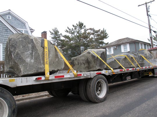 In this March 6, 2013 photo, a truck carryies large boulders as part of a sea wall construction project arriving at the Bay Head N.J. beachfront. Since Superstorm Sandy, many oceanfront homeowners in Bay Head have installed their own privately funded rock wall to guard against future storms. The town wants to be exempted from a statewide project to build dunes along New Jersey's 127-mile coast which New Jersey Gov. Chris Christie insists will be built.Among opponents of the project is Lawrence Bathgate, a major Republican fund raiser whose help Christie would undoubtedly seek if he runs for president in 2016. (AP Photo/Wayne Parry)
