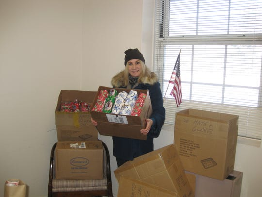 Hope For Veterans Christmas Drive Stacia With Gifts Image.JPG