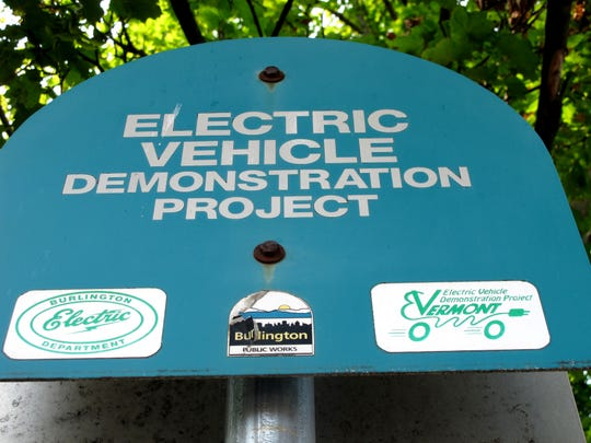 A charging station for electric vehicles is marked with a sign at Church and Main streets in Burlington.