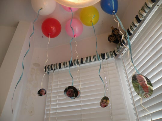Helium balloons with the guest of honor's photo are a nice focal point.