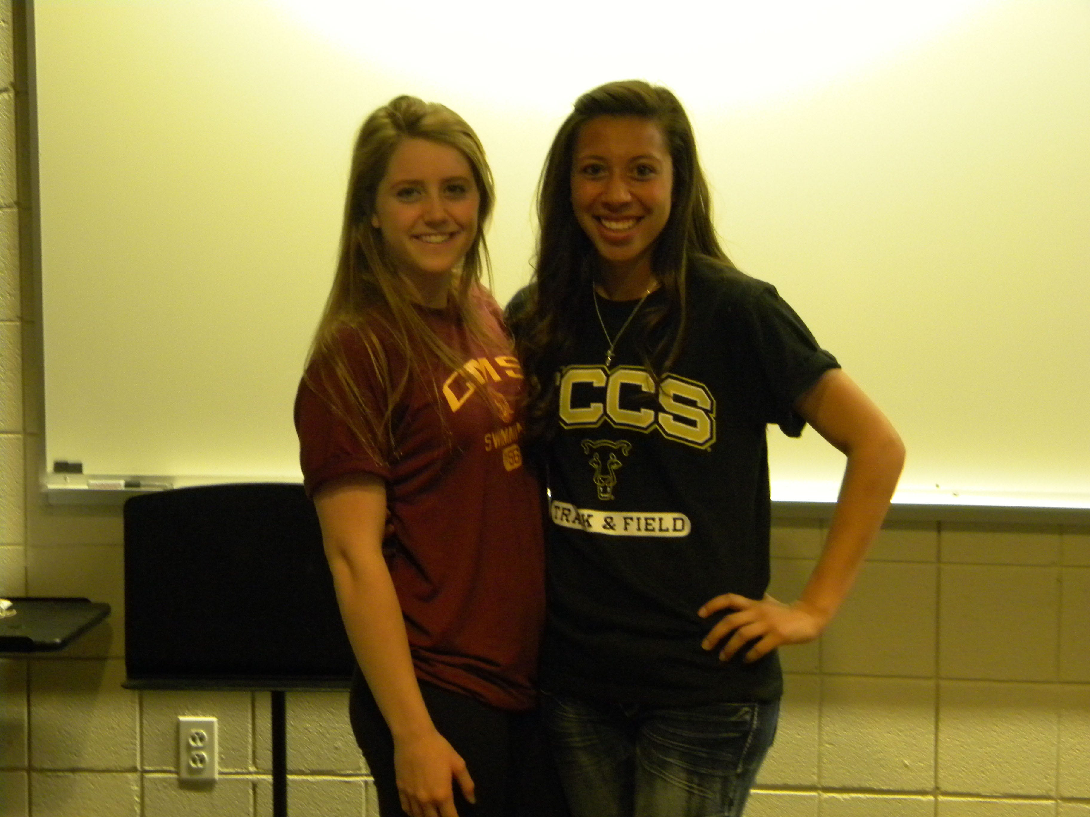 Fossil Ridge's Riley Hoffman, left, and Marah Guzman signed to play college sports.