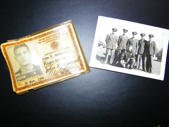 At left is John McConnell's War Department identification card, and at right is a photo of him with the men he trained with, including former senator and presidential nominee George McGovern, who is standing second from left. McConnell is standing second from right.