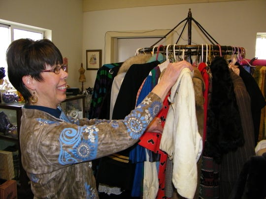 Sue Stoiber works in her Elmore home-based vintage clothing shop. She got her start in the business in 1998 when she became one of the first three sellers of vintage clothing on eBay.