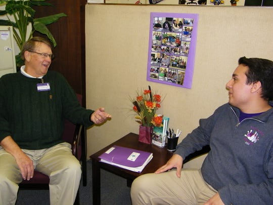 : Dr. Ralph Oxley and Sam Contreras talk during one of their twice-monthly meetings at Ross High School. The mentor relationship between the two helped Contreras make huge leaps in his high school career, and he is now planning to attend Bowling Green State University next fall.