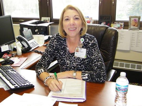 ProMedica Memorial Hospital President Pam Jensen plans to help streamline billing for the Sandusky County Sheriff's Office.