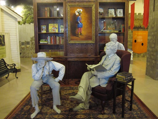 This exhibit in the Mark Twain Boyhood Home & Museum in Hannibal, Mo. depicts Twain contemplating his books and characters, many of which were inspired by his memories of growing up in the mid-1800s in Hannibal.