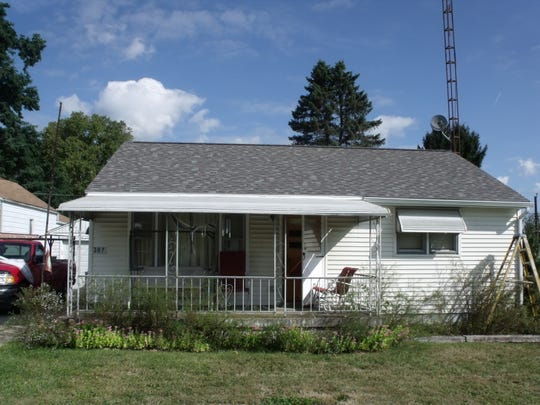 The same house, after the owner applied to the City of Mansfield for help through the Emergency Home Repairs program.