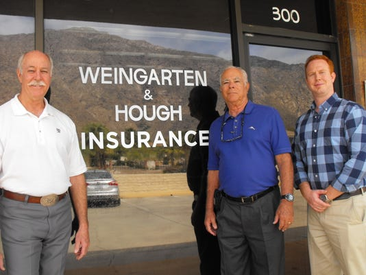 Exterior sign with Greg, Brent and Hunter Hough.JPG