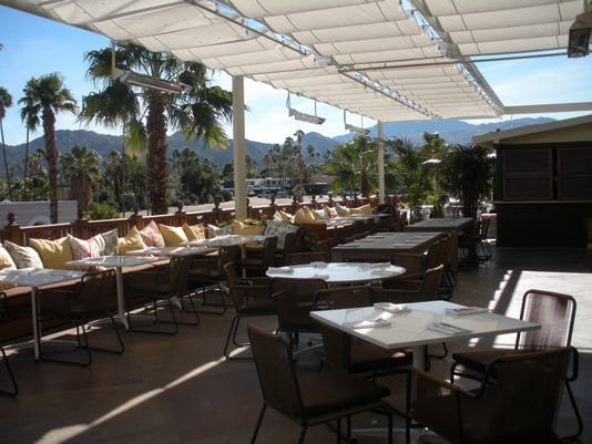 -Tommy Bahama expanded patio.jpg_20120402.jpg