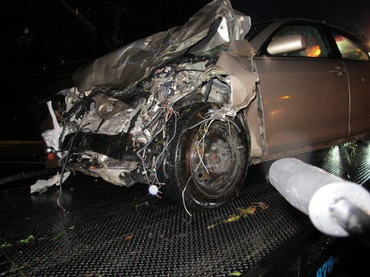 Sarah Walker's smashed Toyota Camry on a tow truck after the wreck on April 18, 2014.