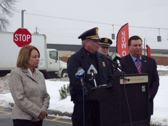 From left to right, Town Board member Shirley Lasker, Police Chief Michael Sullivan, Capt. Robert Mahon and Supervisor Alex Gromack hold a press conference announcing Gromack's proposal for $94.5 million in state funding to boost police coverage at large malls around the state.