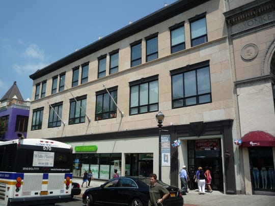 """The Library Lofts in Yonkers is a prime example of a public-private partnership, said Kenneth Adams of the Empire State Development. """"The transformation will contribute to the revitalization of the city's downtown area and generate new economic opportunities for the community."""""""