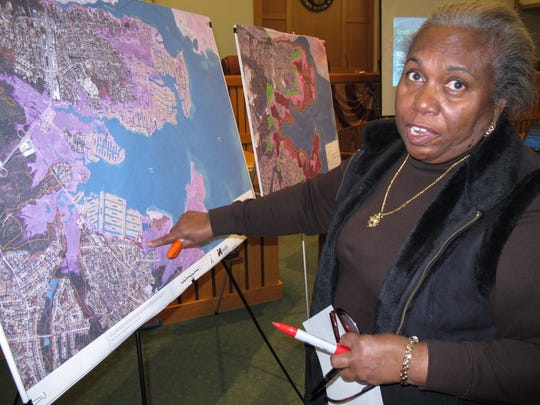 Celeste Evans of Toms River, N.J., points on a map to her section of town that was severely flooded by Superstorm Sandy. She was at a hearing on March 18 at the Toms River municipal building for residents to make suggestions on how to protect against future storms.