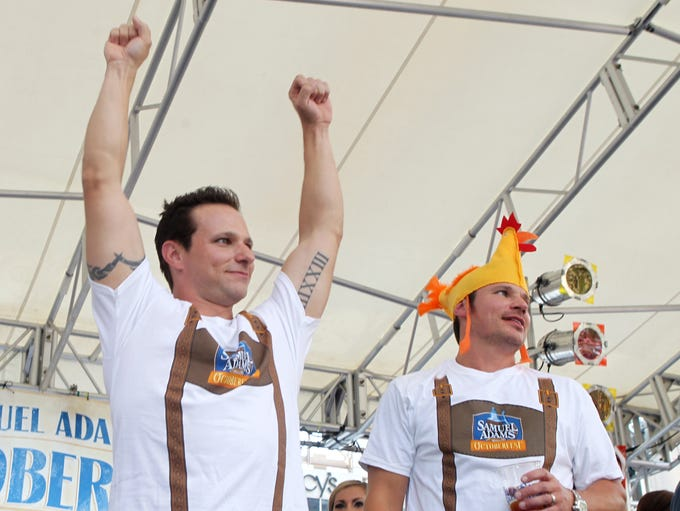 """Drew (left) and  Nick Lachey acknowledge the cheers of  fans after leading the """"Chicken Dance"""" at Oktoberfest Zinzinnati."""
