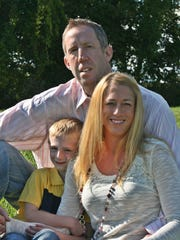 Nate Huffman with his wife, Michelle, and his son,