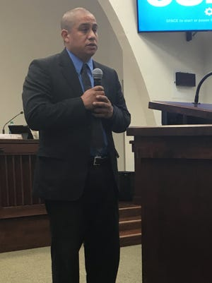 Philip Bautista addresses the crowd after being sworn in as a Coachella city council member in November 2015.