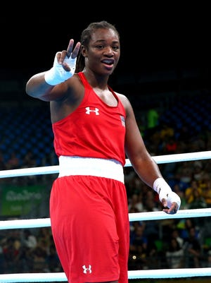 Claressa Shields of the United States celebrates after defeating Yaroslava Yakushina of Russia by points during the Women's Middleweight Quarterfinal on Day 12 of the Rio 2016 Olympic Games at Riocentro - Pavilion 6 on August 17, 2016 in Rio de Janeiro, Brazil.