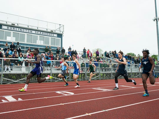 Burlington's Ismail Liban runs in first place during the boys 400m dash during the division I high school track and field state championships at Burlington High School on Saturday June 3, 2017 in Burlington. (BRIAN JENKINS/for the FREE PRESS)