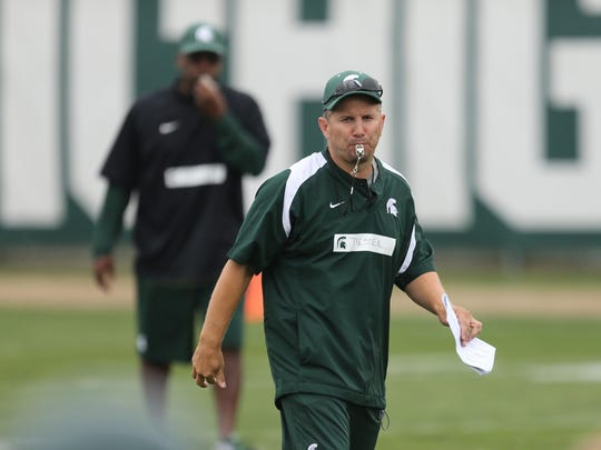 Michigan State Spartan co-defensive coordinator Mike Tressell watches defensive drills during practice on Saturday, August 8, 2015 at the Duffy Daugherty football building in East Lansing.